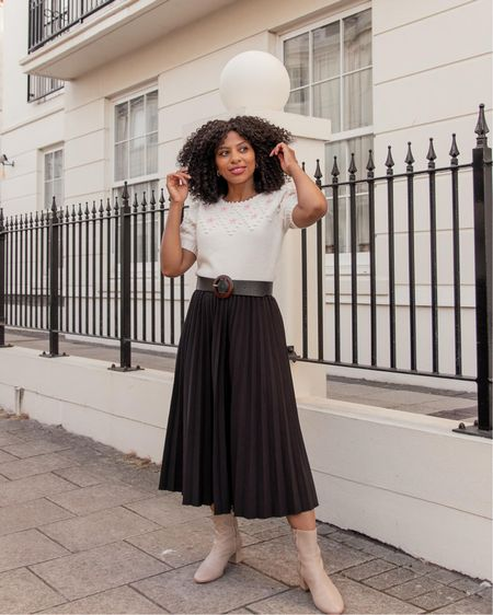 Summer to Autumn transitional look with shortsleeved Other Stories knit jumper, black pleated skirts and Other Stories cream ankle boots.   #LTKstyletip #LTKeurope #LTKSeasonal
