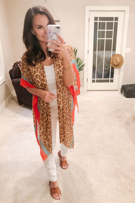 A kimono in the fall and with white jeans (gasp)!! 😆 I say anything goes! I actually love white in the winter too! This leopard color block kimono is no longer stocked but I did link other great fall kimono options.   http://liketk.it/2WIe2 #liketkit @liketoknow.it