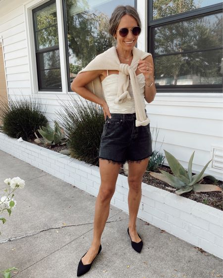 Warm summer evening outfit… black cut off shorts, linen corset top, black flats, and cozy ribbed pullover. All items are sustainably made. I recommend sizing up a 1/2 size in the shoes and going down a size in the shorts //     #LTKstyletip