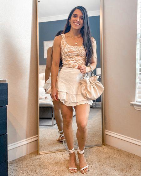 Summer neutral outfit http://liketk.it/3hYR4 #liketkit @liketoknow.it #LTKunder50 #LTKshoecrush #LTKitbag #neutraloutfit #tieupsandals #strappysandals #ruffleskirt