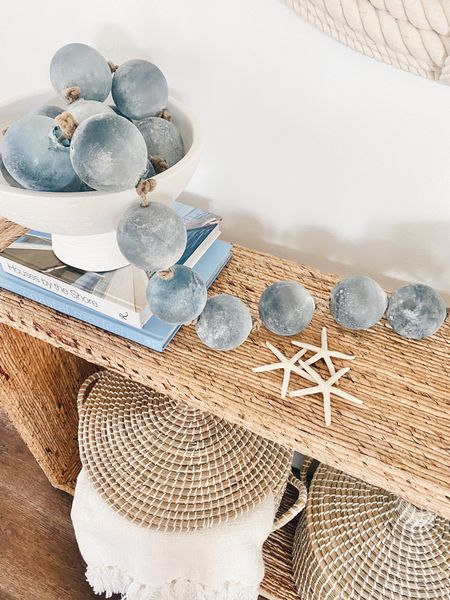 How pretty are these sea glass balls for a coastal home?  I love everything about them especially on this woven console table.    #LTKunder50 #LTKhome #LTKstyletip