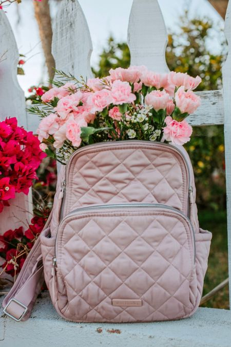 The cutest pink quilted backpack/bag from Vera Bradley is the perfect size for my camera without having to lug around a huge bag.     #LTKitbag #LTKSeasonal #LTKtravel