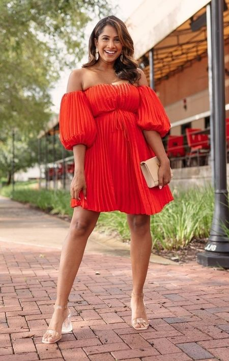 Absolutely the best Wedding Guest outfit from Express.  Pleated Belted Off The Shoulder Trapeze Dress  Yarn Wrapped Double Circle Drop Earrings  #express #weddingguestoutfit #weddingguest #reddress #ladyinred #summerdress