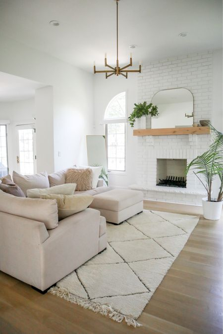 Living room home decor white and airy brick white fireplace mantle mirror