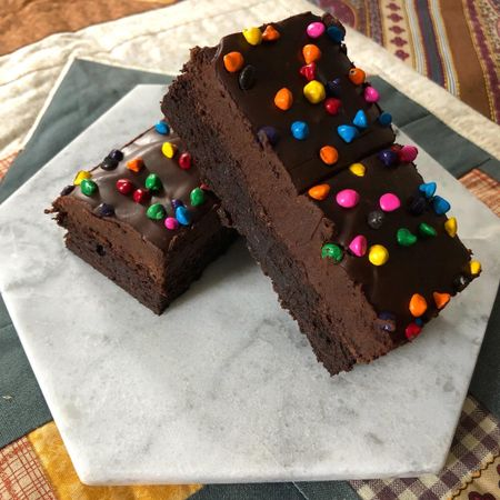 Who else LOVED Cosmic Brownies when they were a kid? Even after I was out of school I used to bring them to work for my after lunch treat (my coworkers made fun of me because I was already the youngest in the office.) The love goes deep.   I tried @handletheheat's recipe last weekend and they are SO GOOD! The texture is right and they're so rich and delicious.  Tessa uses cornstarch and corn syrup in the recipe to help give the brownie its fudgy/chewy texture. We have been keeping them in the fridge so they last longer but I take out a couple while I make dinner so they can come to room temperature before we dig in! Such a fun treat.  P.S. I got 1lb of these rainbow chips so I can make these a million times! (anyone have any other recipes that use rainbow chocolate chips?)  Shop the rainbow chocolate chips here http://liketk.it/37w9x   #cosmicbrownies #baking #homebaker #handletheheat  #brownies #brownielovers #discoverunder5k #bakersofinstagram #liketkit @liketoknow.it #StayHomeWithLTK