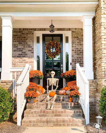 Who's ready for Halloween? We added a little whimsy to our Halloween front porch last year. Home decor Halloween decor fall decor fall wreath front porch decor mums urns doormat  #LTKhome #LTKHoliday #LTKSeasonal