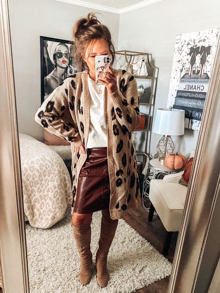 Faux leather skirt runs big, size down. Styled with a animal print cardigan ( comes in grey animal print and Camo) from Target.   Target style, long cardigans, high boots, fall boots, faux leather, workwear outfits, work wear, fall #ltkfall    #LTKsalealert #LTKunder50 #LTKstyletip
