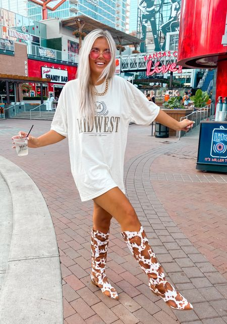 midwest // t shirt dress // oversized graphic tee // cow print // cowboy boots // western // pink sunglasses // casual style // comfy style // WEARING A L/XL in shirt ❤️  #LTKshoecrush #LTKunder50 #LTKstyletip