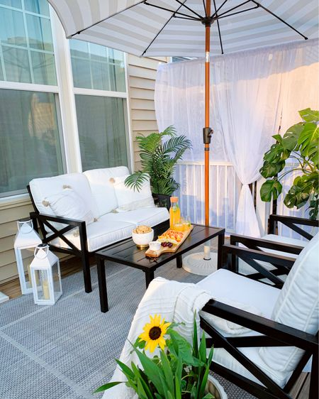My outdoor oasis is ready to shop ! Everything is on sale #smallpatiodecor #patiodecor #outdoorliving #patiofurniture #outdoorfurniture  #LTKhome #LTKtravel