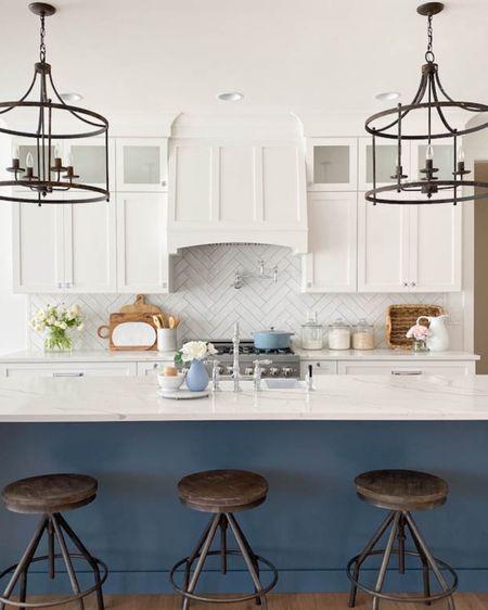 Beautiful white kitchen with navy island. http://liketk.it/3bYxP #liketkit @liketoknow.it #LTKSpringSale #LTKsalealert #LTKhome @liketoknow.it.home Download the LIKEtoKNOW.it shopping app to shop this pic via screenshot