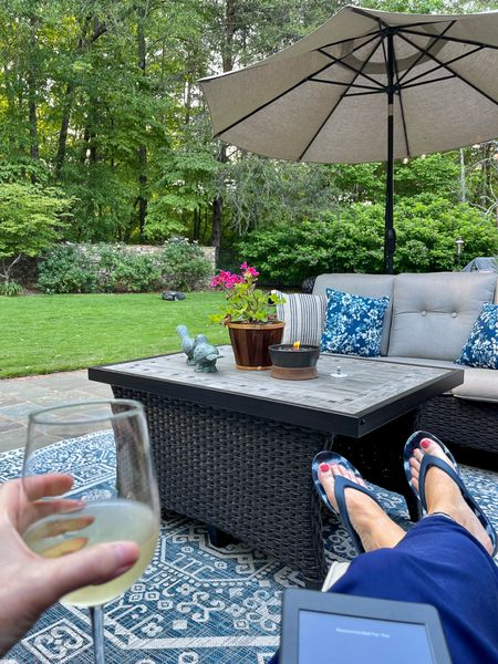 Relaxing on the porch with my Kindle and a glass of wine is the perfect way to wind down! Year 2 of this amazing outdoor wicker furniture with the blue outdoor rug! Complete the look with cafe lights! http://liketk.it/3gSAb #liketkit #LTKstyletip #LTKhome @liketoknow.it @liketoknow.it.home You can instantly shop my looks by following me on the LIKEtoKNOW.it shopping app