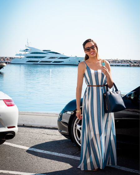 Luxury Summer by the Mediterranean Sea.  Today's outfit is perfect for an elegant yacht day at @puertobanus in the Spanish paradise  of #Marbella.  I am wearing a light white navy striped maxi dress with a navy blue handbag from Nordstrom, and brown accessories. All combined with a brown waist belt from ASOS and amazing turtoise shell sunglasses from Saks Fifth Avenue. Balmain Paris eyewear is my total favorite!  .....  You can instantly shop my looks by following me on the LIKEtoKNOW.it shopping app @BrunereauLaura and @LuxeFashionBlog ..... TODAY ONLY  is the BIGGEST SUMMER SALE. Ship via the @liketoknow.it app and get extra discounts from all our partner brands.   http://liketk.it/2SDY2   Screenshot this pic to get shoppable product details with the LIKEtoKNOW.it shopping app.  .....  #liketkit #LTKsalealert #LTKDay #LTKspring  #marbellapeople #puertobanus #luxurystyle #marbellalifestyle #yacht #fashionblogger #outfitoftheday #summeroutfit
