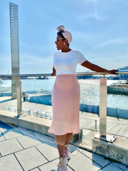 Even the simplest #springoutfit can be elevated with rose gold sneakers and a head wrap with white t-shirt and pink satin slip skirt #nike #targetstyle #springstyle  #LTKstyletip