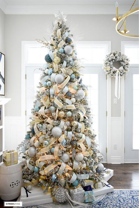 Gorgeous flocked Christmas tree in soft blues golds and silvers! With a touch of the softest green/aqua!   #LTKHoliday #LTKhome #LTKstyletip