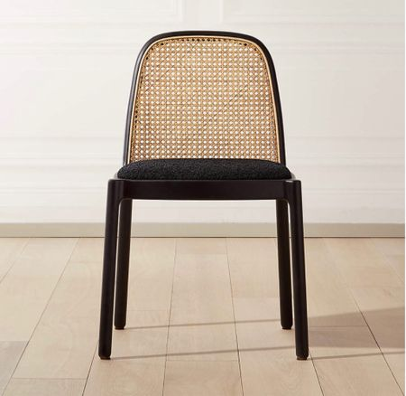 We finally decided on chairs and barstools for the kitchen and I can't wait for them to come in! I love the caning and the black accents (& black seat cushions because #kids). Comes in dining, counter, and bar height (all linked). #kitchen #chair #kitchenchair #diningchair #kitchenseating #black #blackchair #canedchair   #LTKfamily #LTKhome