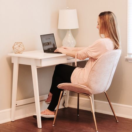 Loving my white desk with blush pink chair .  The table lamp completes the look.  Great for a home office or homeschool room . z  Shop your screenshot of this pic with the LIKEtoKNOW.it shopping app   http://liketk.it/2V7HV #liketkit @liketoknow.it @liketoknow.it.home #StayHomeWithLTK #LTKhome #LTKsalealert kid playroom desk child desk work from home glam office