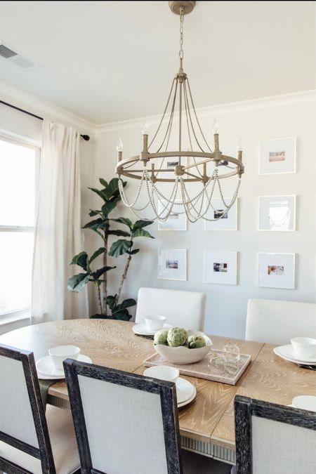 Relaxed dining room design with beaded chandelier and linen curtains. Light washed wood dining table and inexpensive gallery wall. Full tutorial on thesouthernsource.com http://liketk.it/3h9m6 #liketkit @liketoknow.it #LTKhome