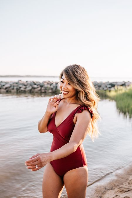 Wine colored one piece V-neck swimsuit with ruffles around the shoulders.  This swimsuit is under $35 and comes in multiple colors.  Paired with white cover up. http://liketk.it/2U0EC @liketoknow.it #liketkit #rStheCon #LTKstyletip #LTKunder100 #LTKunder50 Download the LIKEtoKNOW.it app to shop this pic via screenshot