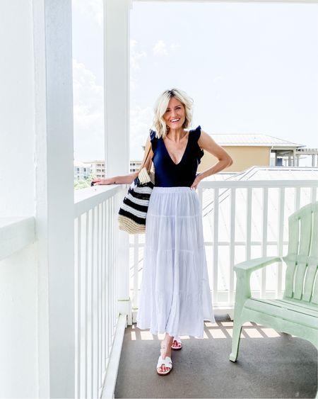 Black one piece and white skirt http://liketk.it/2SrmG #liketkit @liketoknow.it