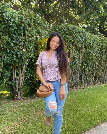 I styled this floral wrap blouse with distressed jeans. Also wearing my crossbody bag from Michael Kors  #LTKitbag #LTKstyletip #LTKsalealert