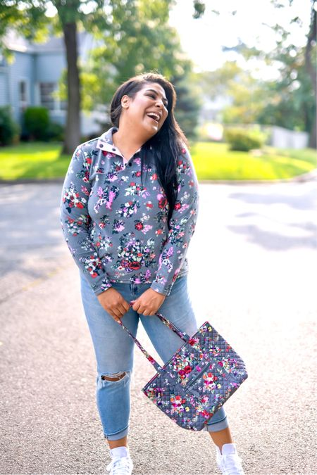 """5% of profits of Vera Bradley new print in Hope Blooms goes to breast cancer research! Use code """"queencarlene"""" for an additional 10% off   Sweatshirt (L), jeans are seven (31, TTS), & shoes are converse (size down 1.5 sizes)  Vera Bradley collection, travel essentials, #verabradley, travel must-haves, backpacks, floral bags, Vera Bradley travel, casual style, midsize, mid size, aerie, light denim jeans, converse, high rise denim, size 12, size 14, high tops, fall fashion, fleece, sherpa   #LTKSeasonal #LTKcurves #LTKunder100"""