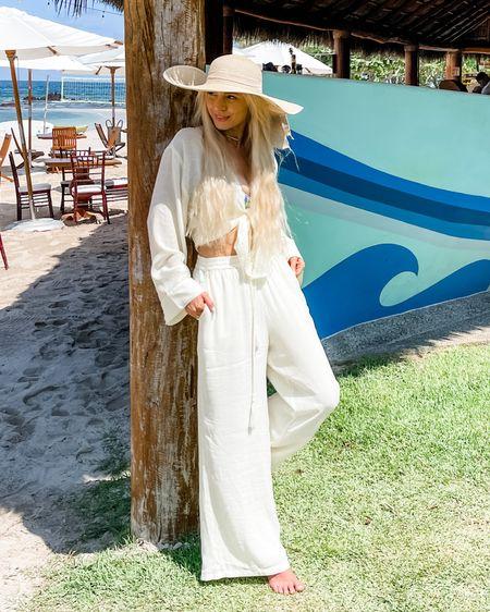 Beach outfit, beach style, vacation style, cover up, linen pants, white pants #LTKtravel #LTKstyletip #LTKswim  http://liketk.it/3etFv #liketkit @liketoknow.it
