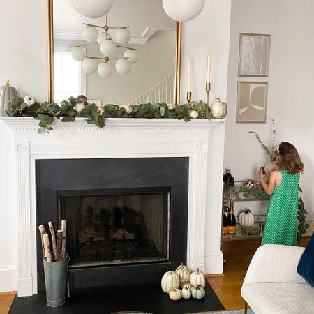 Fall home decor, fireplace, mantle, large gold mirror, wall art, white pumpkins, mantle decor http://liketk.it/2WR05 #liketkit @liketoknow.it #StayHomeWithLTK #LTKhome