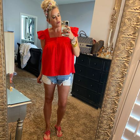 Star spangled…❤️🇺🇸💙🧨 . .#outfit inspo ….   Looking for Ideas to create a fun 4th look? Here's another idea…. Red top, denim shorts, red sandals (Tory Burch miller's)  festive accessories ❤️🇺🇸💙🧨 . . Head to my blog for more inspo.. search 4th of July🇺🇸. . . .  Shop my daily looks by following me on the LIKEtoKNOW.it shopping app Download the LIKEtoKNOW.it shopping app to shop this pic via screenshot http://liketk.it/3iHPu #liketkit @liketoknow.it #LTKstyletip
