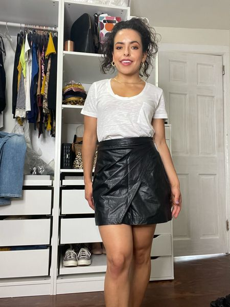 Wearing $12 tee and Freepeople faux leather skirt from the Nordstrom Anniversary Sale. If you want a closer fit size down in the tee as it's a bit loose!    #LTKunder50 #LTKsalealert #LTKunder100
