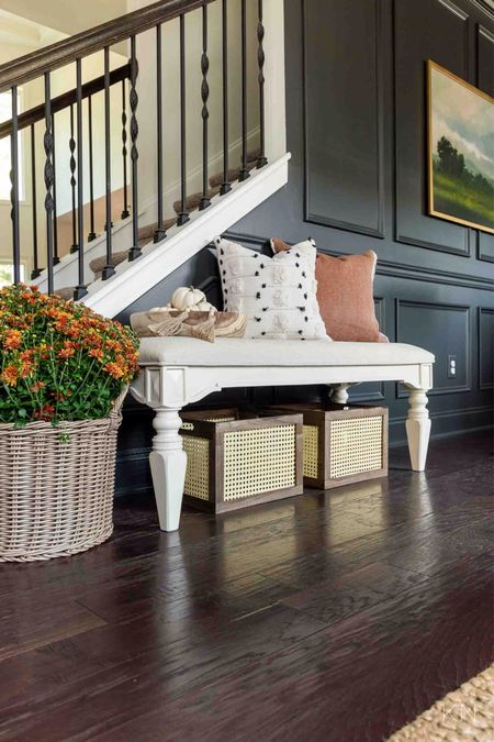 My foyer is decorated for fall with some affordable finds from Walmart! Home decor bench cane crate plant basket fall pillow wooden beads wooden bowl minted art  #LTKhome #LTKunder50 #LTKSeasonal
