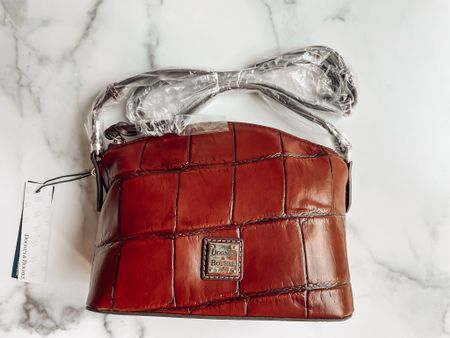 Huge sale on the Dooney & Bourke Denison Croco Ruby Crossbody! Cute purse for fall  The QVC price is $155.42, and the retail price is $188.00. -First time customers can get $10 off with code OFFER. #qvc #qvcinfluencer  #LTKitbag #LTKsalealert