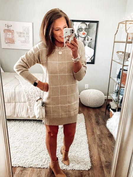 Sweater dress and boots from Pink Lily Boutique styled with them shoe booties from Target  Sweater dress, boots, trendy, trends, fall dresses, dresses, date night, workwear, holiday outfit   #LTKsalealert #LTKHoliday #LTKunder50