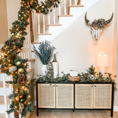Obsessed with my new piece of furniture!! 🎄 This is probably one of my favorites in the entire house! ❤️ Plus this garland coming down the staircase! 😍 I'm thinking of hanging a flocked wreath over the table what do y'all think???  💕 You can instantly shop my looks by following me on the LIKEtoKNOW.it shopping app 💕  #LTKsalealert #LTKstyletip #LTKhome   http://liketk.it/31x0m #liketkit @liketoknow.it