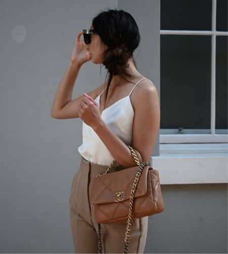 I love creating a simple neutral look with some clothings basics, then adding the finishing touch with a bag… my Chanel 19 small caramel 😍  White strap top with some camel high waist trousers, team with a longline jacket for autumn 🙌  #LTKstyletip #LTKSeasonal #LTKworkwear