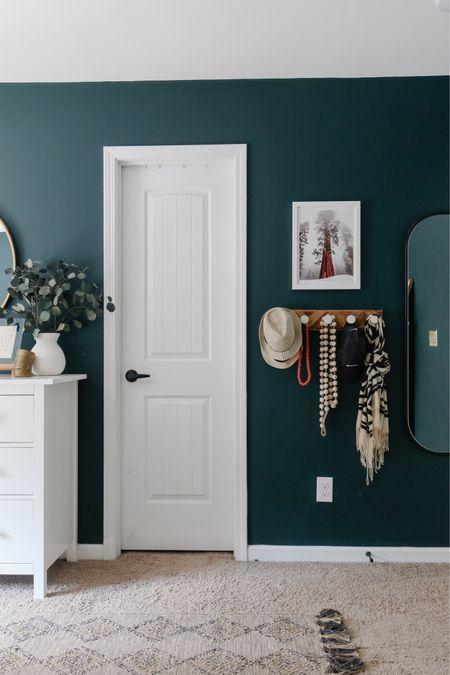 Oval mirror, wall hooks, primary bedroom decor, harlequin rug  #LTKunder100 #LTKhome