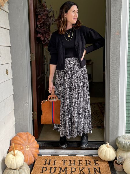 Styling the cropped Irene cardigan from @able - use code ARTINTHEFIND20 for 20% off   Skirt - thread and seed  Bag - @clarev   Boots - @madewell    #LTKHoliday #LTKSeasonal #LTKstyletip