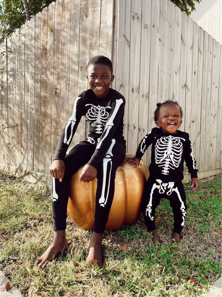 Skeleton Halloween pajamas for big boy and baby girl! These can even double as a simple skeleton costume. Sizes 9/10 in boys and 2T in toddler.   #LTKbaby #LTKfamily #LTKkids