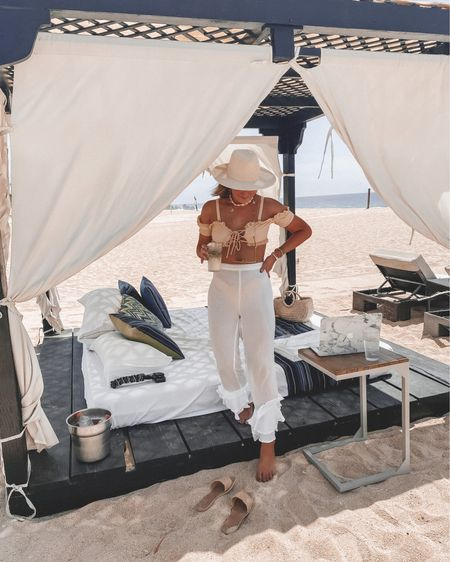 cabana life in this beautiful peach bathing suit (wearing a US 4) and these fun white pants (sold out).  http://liketk.it/2WHOm @liketoknow.it #liketkit #LTKtravel #LTKswim