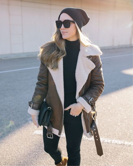 This Avec Les Files oversized moto jacket is sold out, but I linked similar styles with shearling trim from brands I love and trust! #motojacket #brownmotojacket #shearlingjacket #motojacketstyle #motojacketoutfit