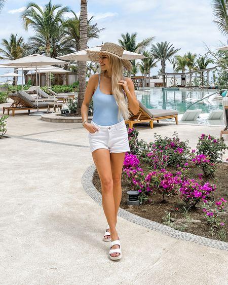 Beach outfit, vacation outfit, white shorts, jean shorts, agolde shorts, Parker shorts, blue bathing suit, one-piece swimsuit, crinkle swimsuit http://liketk.it/3etKo #liketkit @liketoknow.it #LTKswim #LTKtravel #LTKshoecrush