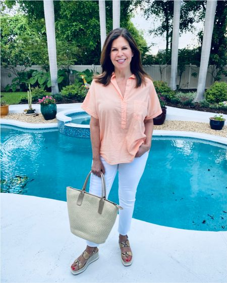 Happy Friday, people! 👋🏻  What's on your agenda today?  Work for me, then I'll be taking a dip in the pool. 💦   I'm beating the summer heat today in one of my favorite @grayson tissue cotton blouses - The Artist - how fun is this color? Cantaloupe!  If you haven't tried a Grayson tissue cotton blouse, this would be a great first choice.  Use the Grayson link in my Linktree bio for $25 off your first shirt, and use code GWENGOTTLIEB - you can also swipe up in my Grayson highlights or stories.  Paired this light, breezy top with my @lovechicos so-slimming white ankle jeans, so I'll be comfy cool all day.  If you're still shopping the summer sales, you must check out all the steals at Chicos. Fabulous!! 🛍   You can also 𝑺𝒉𝒐𝒑 𝑴𝒚 𝑰𝒏𝒔𝒕𝒂𝒈𝒓𝒂𝒎 & 𝑳𝑰𝑲𝑬𝒕𝒐𝑲𝑵𝑶𝑾.𝒊𝒕 - 𝑳𝒊𝒏𝒌 𝑰𝒏 𝑩𝒊𝒐! - for the jeans, tote, and wedges - @dolcevita - so cute, right? Swipe for a close-up!  Wonder how my #fashionfriday friends are keeping cool today… 🤔   @patrishpages  @melaniespickett  @robinlamonte   @mymidlifestylist  @deborahsorlie  @joyousstyling  @overfiftyandblessed @jaxvegancouple  Tell me, how are you beating the summer heat? ⬇️  #summerstyles #summerfashion  #beattheheat  #MyStyleMyWay #Over60andfabulous #LoveChicos #Grayson #SouthFlorida #BoyntonBeach #FloridaBloggers     #LTKsalealert #LTKcurves #LTKshoecrush