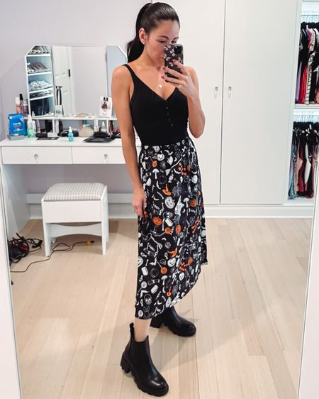 A fun fall look with a Halloween themed skirt - linking a few other options in both regular and plus size! Under $50.   #LTKunder50 #LTKstyletip #LTKSeasonal