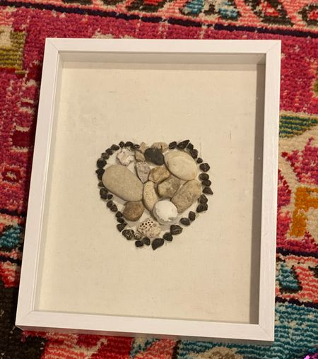 Creating art from rock collections . Buy a shadow box frame and hot glue game. Have your kids draw out a design and glue the rocks onto it.    #LTKhome #LTKkids #LTKfamily