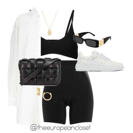 Simple biker shorts look with a white shirt and a black bra top