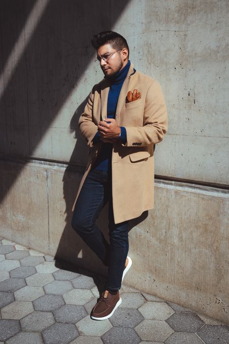 A camel coat is a timeless staple for any wardrobe. Did you know camel coats were made of camel hair? Camel began to establish itself in the early 20th century. Launched at the end of wartime in 1919, the camel coat, as designed by Jaeger (a UK fashion brand), put London on the fashion map as Paris and its style industry took time to recover from the devastating effects of the First World War.  Turtleneck for men. Blue turtleneck. Turtleneck style. Menswear turtleneck.   #LTKworkwear #LTKmens