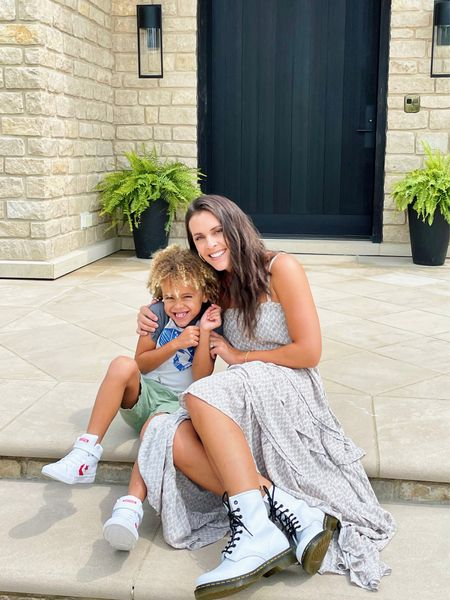 Jumping for joy in our new shoes from @DSW! Isn't it awesome how new shoes make you jump higher 😉? #ad Myles just got his new back to school shoes from @DSW and I did some browsing myself and got these super cute boots to transition my summer dresses to fall. Sure hope this little dude always hugs me this tight! #myDSW #boymom #bootswithdresses   #LTKkids #LTKshoecrush #LTKbacktoschool