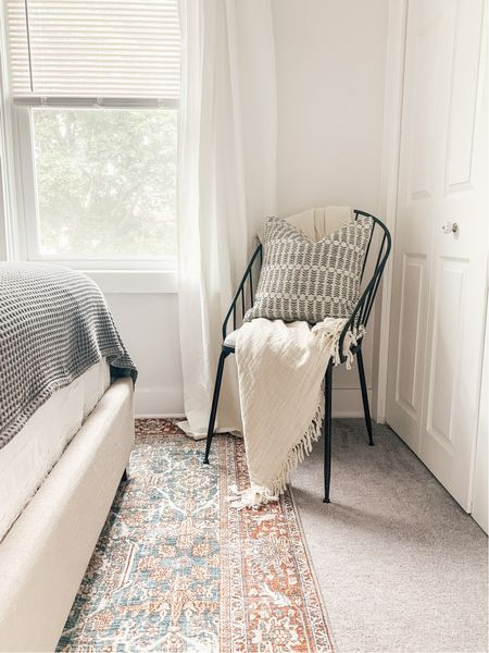Bedroom with vintage area rug and cozy modern corner chair with neutral pattern throw pillow.   #LTKhome