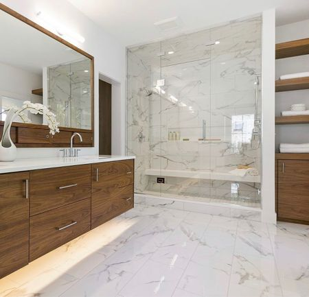 Refreshing your bath for holidays? We love the LED lighting effect underneath the modern walnut floating vanity which adds interesting depth and dimension to this crisp white space.   #LTKhome #LTKfamily #LTKHoliday