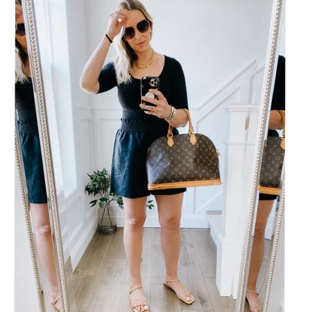Basic and classic summer outfit.   Linen pull on shorts - longer style, elastic waist, pockets. Run generous.   Reformation scoop neck black tee - softest fabric, really stretchy. Looks like a bodysuit without the hassle.   Marc Fisher nude flat sandals   Mom shorts, black shorts, t-shirt, Ann Taylor, reformation, summer look  #LTKstyletip #LTKtravel #LTKunder100