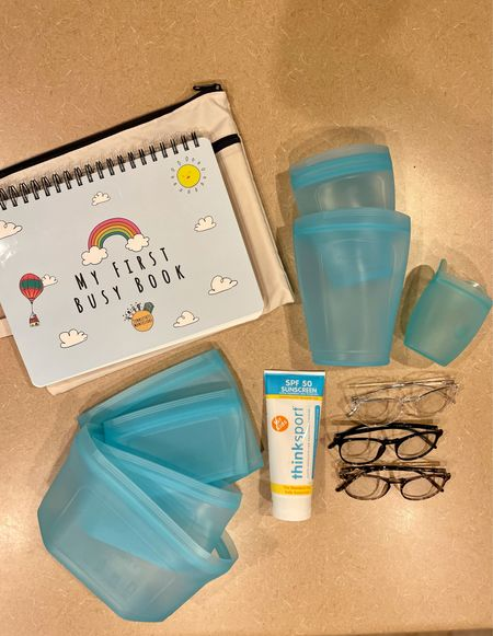 Amazon haul. Toddler busy book for traveling. Safe sunscreen. Blue light glasses. And reusable silicone food container bags.   #LTKkids #LTKunder50 #LTKhome